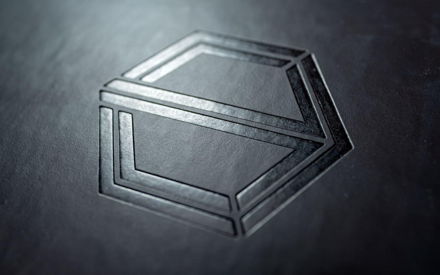 Trans Auriga Logo Prägung
